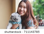 close up of young asian woman... | Shutterstock . vector #711143785