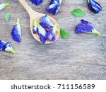 wooden spoon with blue... | Shutterstock . vector #711156589