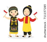 two happy girls in dayak and... | Shutterstock .eps vector #711157285