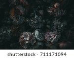 Stock photo textile flowers in darkness 711171094