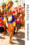 Small photo of Women in traditional costumes marching at the Umhlanga aka Reed Dance ceremony - 01-09-2013 Lobamba, Swaziland