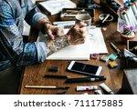 side view of tattoo artist man... | Shutterstock . vector #711175885