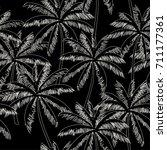 white  outline palm trees on... | Shutterstock .eps vector #711177361