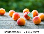 beautiful ripe orange apricots... | Shutterstock . vector #711194095