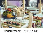 preparation for the banquet.... | Shutterstock . vector #711215131