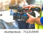 camera in the hands of a... | Shutterstock . vector #711215545
