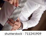 man clipping a necktie with a... | Shutterstock . vector #711241909