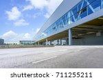 a modern factory building  | Shutterstock . vector #711255211