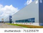 a modern factory building  | Shutterstock . vector #711255379