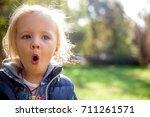portrait of a cute little girl... | Shutterstock . vector #711261571
