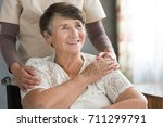 hopeful senior woman receiving... | Shutterstock . vector #711299791