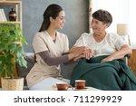 retirement home volunteer... | Shutterstock . vector #711299929