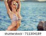pretty beautiful woman in white ...   Shutterstock . vector #711304189