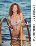 redhair woman in bikini relaxed ... | Shutterstock . vector #711305239