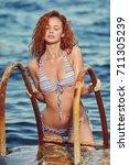 redhair woman in bikini relaxed ...   Shutterstock . vector #711305239