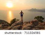 woman enjoying the sunset at... | Shutterstock . vector #711326581