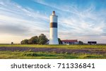 lange jan lighthouse at sunset... | Shutterstock . vector #711336841