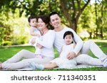 young happy asian family... | Shutterstock . vector #711340351