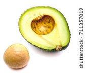 Small photo of Sliced avocado (Persea americana, alligator pear) with a stone isolated on white background