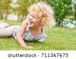 shot of a cute little girl with ... | Shutterstock . vector #711367675