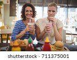 portrait of smiling young... | Shutterstock . vector #711375001
