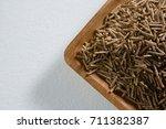 cereal bran sticks in wooden... | Shutterstock . vector #711382387