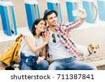 young tourists sitting on... | Shutterstock . vector #711387841