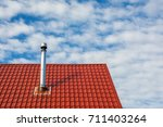 chimney on roof | Shutterstock . vector #711403264
