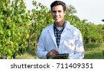 portrait of an agronomist... | Shutterstock . vector #711409351
