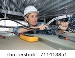 female electrician installing... | Shutterstock . vector #711413851