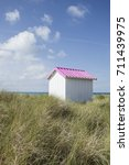 Small photo of Beach hut in the dunes. Colorful wooden beach cabins at Gouville-sur-Mer, France