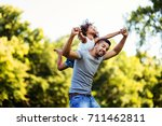 portrait of young father... | Shutterstock . vector #711462811