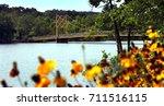 beaver bridge crosses the white ...   Shutterstock . vector #711516115