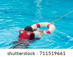 Small photo of use ring buoy help man drowning in pool