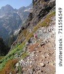 Small photo of SNOQUALMIE PASS WASHINGTON - SEP 27, 2012 - Hikers climbing steep mountain trail near Snoqualmie Pass, Washington