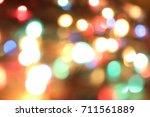 abstract circular bokeh ... | Shutterstock . vector #711561889