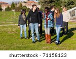 Stock photo college students walking and talking at park 71158123
