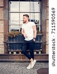 young guy with a beard and... | Shutterstock . vector #711590569