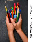 colorful pencils in hand... | Shutterstock . vector #711592231