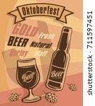 bottle and a full glass of beer.... | Shutterstock .eps vector #711597451