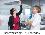 kitchen inspector feeling... | Shutterstock . vector #711609367