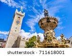 Small photo of Fontana del Nettuno (Neptune fountain) in Trento - Trentino - Italy - Torre Civica or Torre di Piazza on the background