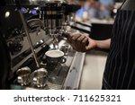mid section of waiter making... | Shutterstock . vector #711625321