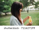 young caucasian woman with ice... | Shutterstock . vector #711627199