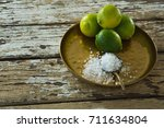 salt and lime in a plate on... | Shutterstock . vector #711634804