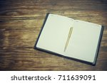 pen and notepad | Shutterstock . vector #711639091