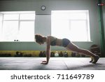 a beautiful girl does push ups... | Shutterstock . vector #711649789
