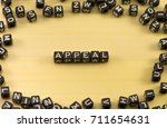 Small photo of The word appeal on wood background