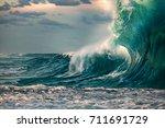 huge ocean wave during storm.... | Shutterstock . vector #711691729