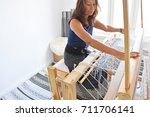 an asian women do hand woven in ... | Shutterstock . vector #711706141